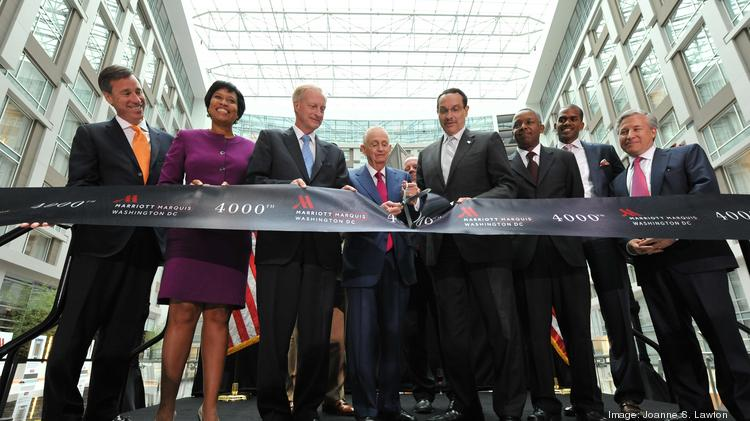 Marriott International Executive Chairman Bill Marriott, center in red tie, helps Mayor Vincent Gray cut the ribbon at the Marriott Marquis across from the Washington Convention Center on Tuesday. Others pictured, from left, include Marriott CEO Arne Sorenson, D.C. Councilwoman Muriel Bowser, D.C. Councilman Jack Evans, Capstone Development's Norman Jenkins, Events D.C. CEO Greg O'Dell and Chris Gladstone of Quadrangle Development.