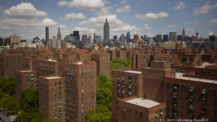 The Empire State building stands in the skyline past Stuyvesant Town- Peter Cooper Village, Manhattan's largest apartment complex.