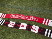 The 12-piece product line will also feature Bethlehem Steel scarves.