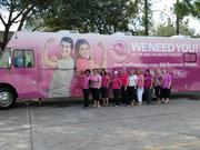 Members of Certified Slings in front of Florida Hospital's Pink Army bus.