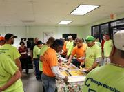 A long line forms for the Comprehensive Energy Services holiday cookout.