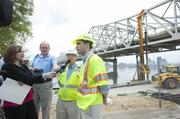 Andy Barber, project manager with the Kentucky Transportation Cabinet, right, and Max Rowland, of Walsh Construction, answered reporters' questions about the test shaft drilling.