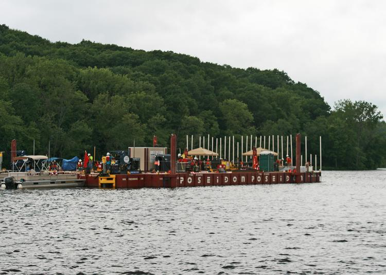 A GE barge, water testing for Hudson River PCB dredging project in Fort Edward. Cleanup crews are beginning a fourth year of removing PCBs from the Hudson.