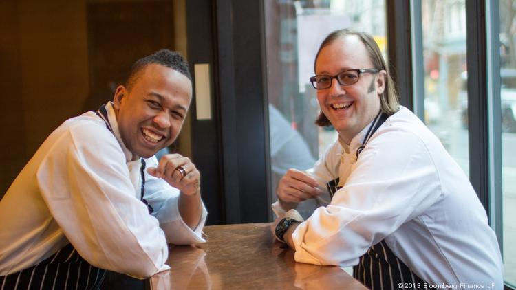 Malcolm Livingston II, pastry chef of wd~50 restaurant, left, shares a laugh with Wylie Dufresne, chef and owner, at wd~50 in New York. When wd~50 opened in 2003, it was a rare outpost for fine dining on Manhattan's Lower East Side.