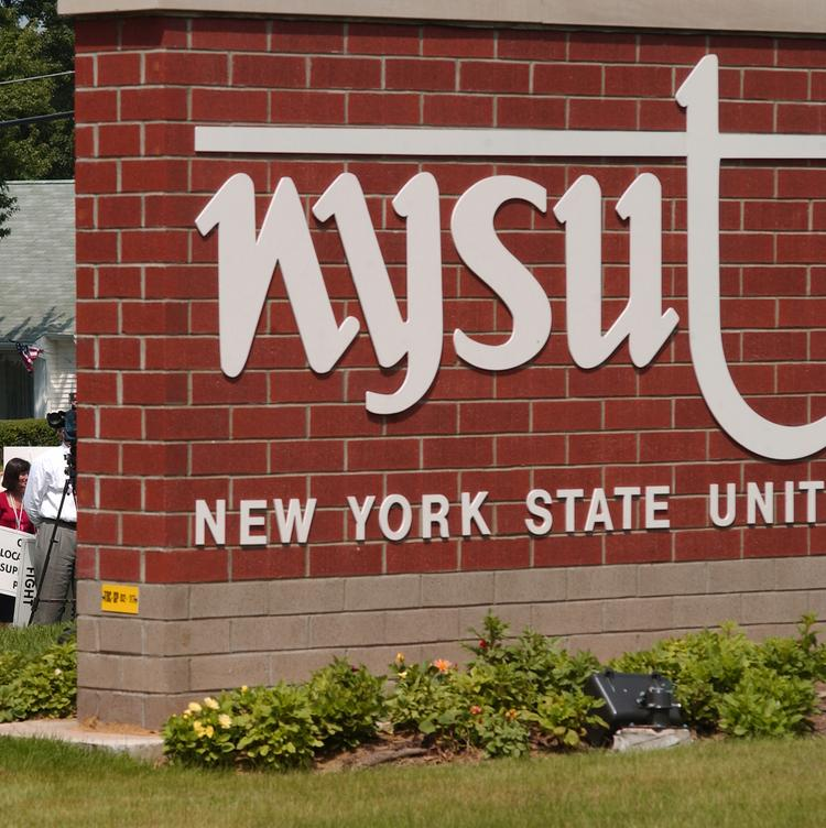 New York State United Teachers filed a lawsuit challenging the Cuomo administration's property tax cap.