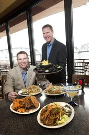From left, Matt and Michael Higgins are shown with several of the new offerings available at Tumbleweed.