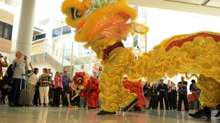 A traditional Lion Dance opened the new American Airlines daily routes to Shanghai and Hong Kong Wednesday at DFW Airport.