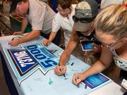 Spirit AeroSystems employees sign a banner marking the delivery of 5,000 next-generation Boeing 373 fuselages.