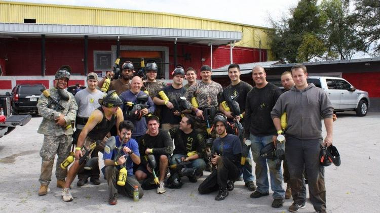 Market Traders Institute's employees enjoy a paintball outing.