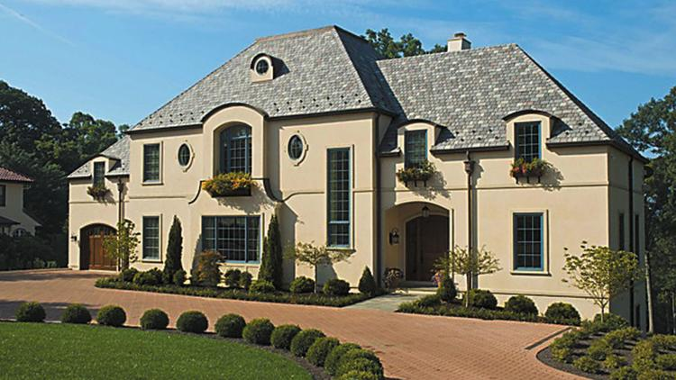 The stucco exterior of the LEED Platinum home in Hyde Park calls to mind a country villa.