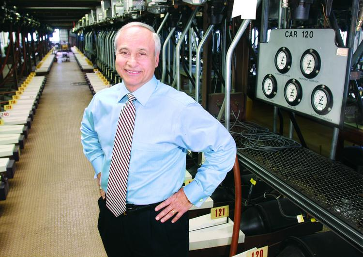 Albert Neupaver is president & CEO of Wabtec Corporation in Wilmerding. He is standing near a brake system test rack that simulates 250 rail cars.