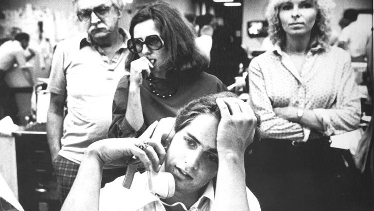 Buffalo Courier-Express employees learn from a television newscast on Sept. 18, 1982, that last-ditch efforts to save the paper have failed. It folded the next day. Copy aide Mark Matays is in the foreground, with reporters Joe Higgins, Sara Solovich and Rose Benz behind him.