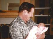 In 1997, Walt Imhoff held his granddaughter, Grace.