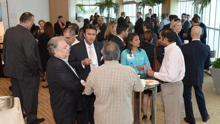 Networking takes place before the HSBC Global Connections panel discussion on conducting business in India.