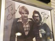 An autographed photo of comedian Steve Martin with Chuck Morris on New Year's Eve 1974 hangs in Morris' office.