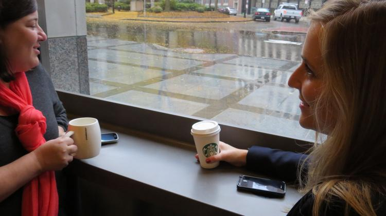 Starbucks launched Powermat Spots in San Jose, Calif., and Boston on Thursday that will wirelessly charge certain smartphones.