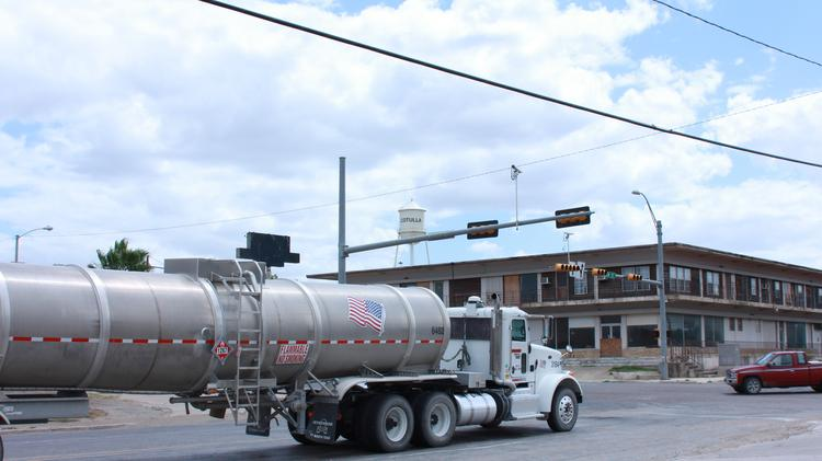 A tanker truck moves through the Eagle Ford Shale town of Cotulla. Investment company Ares Management LP is buying San Antonio's BlackBrush Oil & Gas, which holds 160,000 acres in the shale.