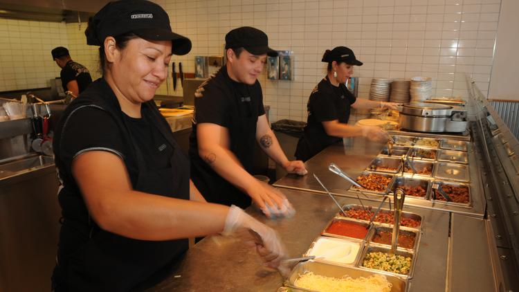 Angelica Mora, Josh Pisani and Margarita Flores work at the Chipotle on 16th Street Mall and Blake during lunch.