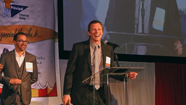 Cliff Johnson, chief operating officer and co-founder of Vacasa accepts the award as the fastest growing company.