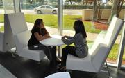 Rosa Agilar and Lissette Sanchez use a small space on the side to meet.