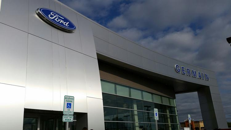 The new exterior is meant to give Ford stores a uniform look across the country.