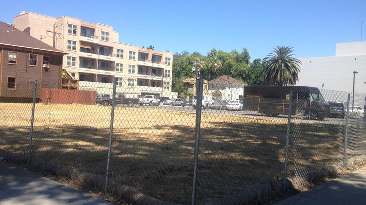 A largely empty lot at 21st and Capitol streets rumored to be future parking for a Whole Foods a block to the north in midtown is being submitted to the city for conversion into ... a parking lot.