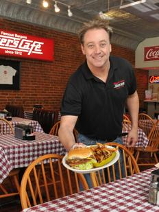 Mark McMinn of Dyer's serves up one of Memphis' classic burgers.