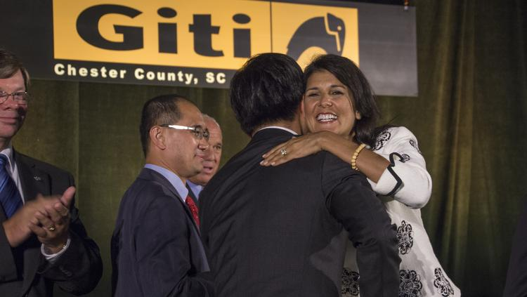S.C. Gov. Nikki Haley (right) thanks Giti Tire Group Executive Chairman Enki Tan at the Chester County at the announcement of Giti's production facility in Chester County.
