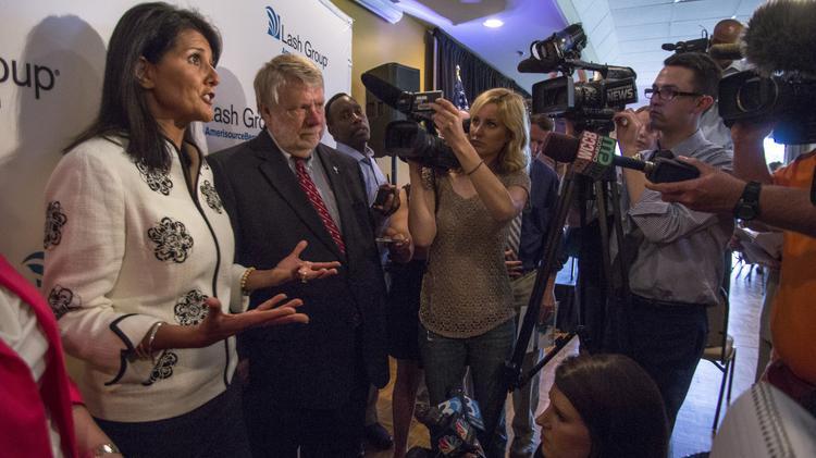S.C. Gov. Nikki Haley (left) and S.C. Commerce Secretary Bobby Hitt respond to reporters' questions about The Lash Group's headquarters move.