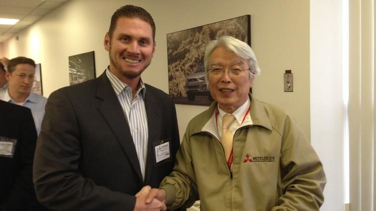 Jeremy Franklin (left), owner of Jeremy Franklin Mitsubishi in Kansas City, poses for a photo with Mitsubishi Motors North America Chairman Gayu Uesugi.