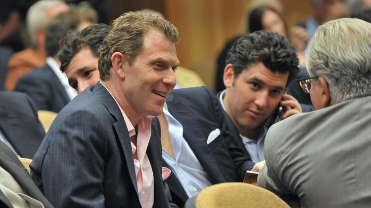 Chef Bobby Flay, left, shown here at the 2012 Fasig-Tipton Saratoga yearling sales,  is a frequent attendee at Thoroughbred auctions.