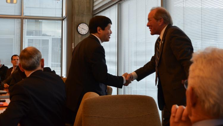 Vietnamese Ambassador Nguyen Quoc Cuong shakes hands with former Oregon Gov. Ted Kulongoski, is a distinguished fellow with PSU's Hatfield School of Government.