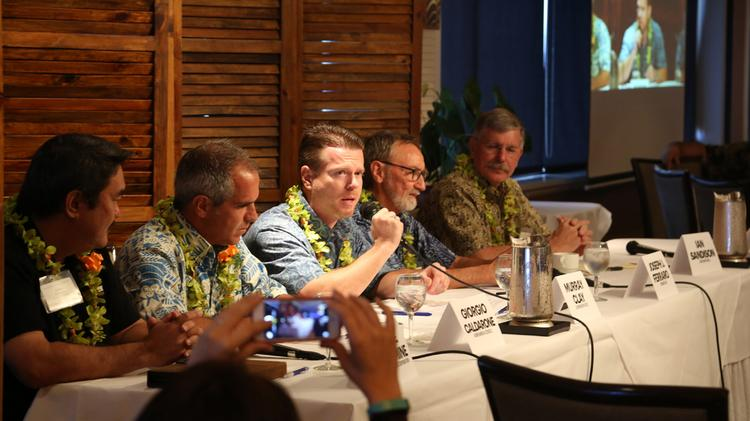 Murray Clay of Ulupono Initiative, center, makes a point during PBN's Sustainability Seminar.