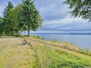 Paul and Pam Schell's Whidbey Island property, selling for almost $4 million, and on the market almost ten months, has easterly views of the Saratoga Passage, Hat Island, and Cascade Mountains.