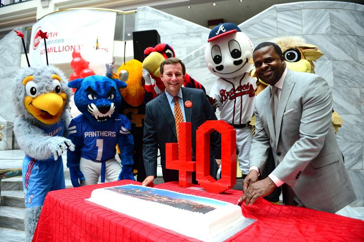 ACVB president William Pate and Atlanta Mayor Kasim Reed cut a cake in part of the 40 million visitors to the city celebration.
