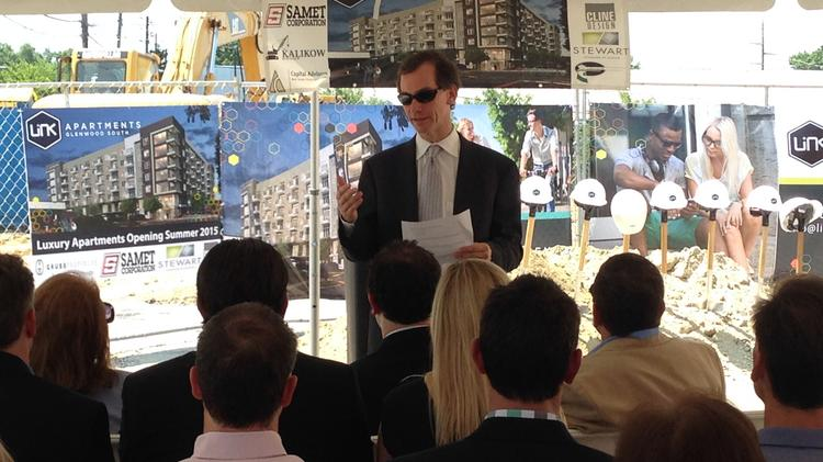 Clay Grubb, CEO of Grubb Properties and developer of the LInk Apartments Glenwood South project on West Street in downtown Raleigh, addresses the crowd attending the project's ground-breaking ceremony on June 17.