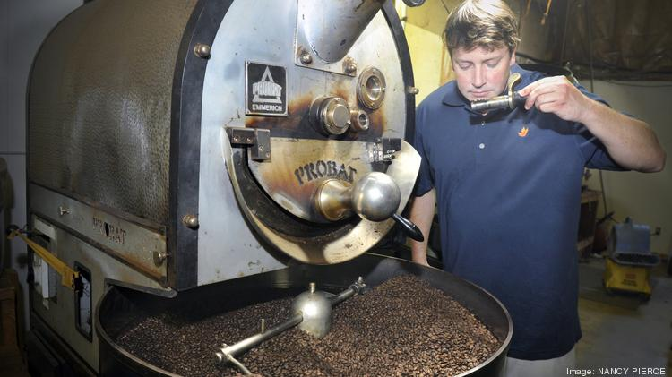 Magnolia Coffee owner Jay Gestwicki checks a batch of beans fresh from the roaster.