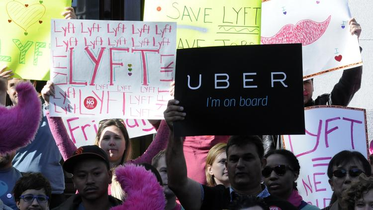In a final effort to oppose new insurance requirements, Uber drivers pulled up to the state Capitol and delivered more than 17,000 signatures to a lawmaker leading the regulatory charge. This is from a previous rally with Uber and Lyft drivers.