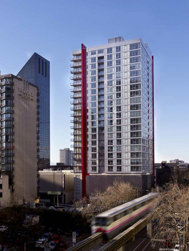 The Martin, Vulcan's new high-rise apartment tower in Seattle, is about to be sold. Vulcan also is selling five other apartment buildings.