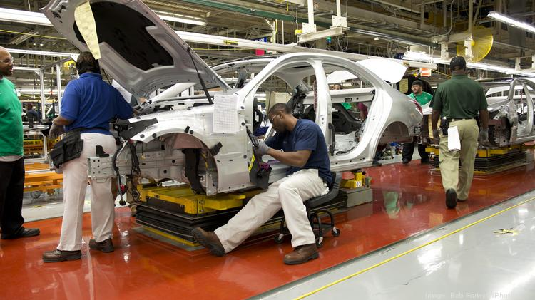 Mercedes, one of the largest manufacturers in Alabama, work on the assembly line.