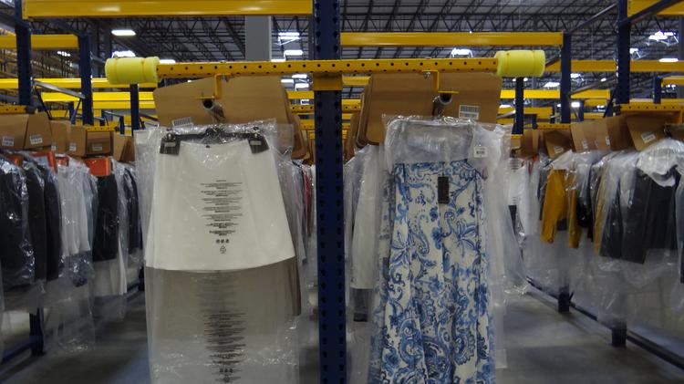 Ralph Lauren clothing hangs inside of the company's massive e-commerce distribution facility at 201 Pendleton St. in High Point. The facility ships online orders to customers across the U.S. and Canada.