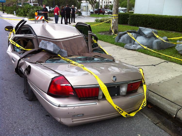 """A destroyed car is """"evidence"""" of a mysterious incident involving giant robots."""