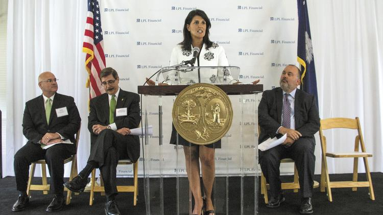 At the Dairy Barn in Fort Mill, (from left) Victor Fetter, CIO of LPL; Britt Blackwell, chair of the York County Council; S.C. Gov. Nikki Haley; and Mark Casady, CEO of LPL announce LPL's move.