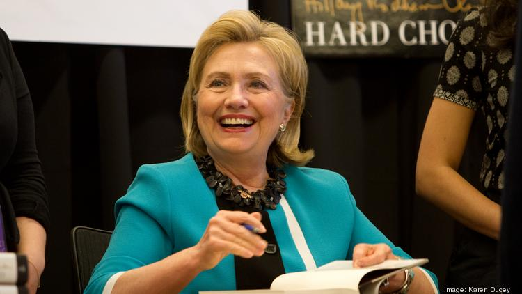 """Hillary Clinton signs her new book """"Hard Choices"""" at a Seattle bookstore."""