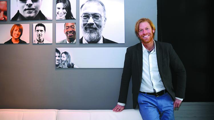 Jeff Douglass, president of Cybis Communications, has produced nine events for the White House. Here, he's shown near a client wall in his firm's office.