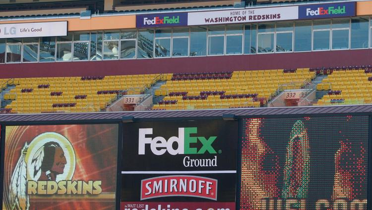 An American Indian tribe and socially responsible investment firms contend FedEx should respond to the reputational damage caused by its sponsorship of the Washington Redskins' stadium.