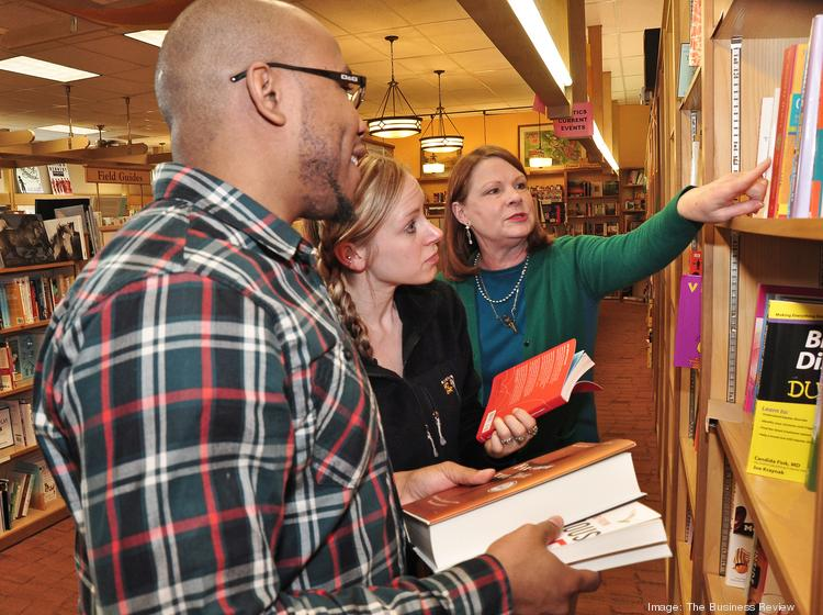 Customers Khalid Miller & Jenn Dailey, with Susan Novotny, owner, The Book House of Stuyvesant Plaza. The lawsuit asserts that book publishers and Amazon have created a monopoly over electronic books which controls prices and hurts independent bookstores.