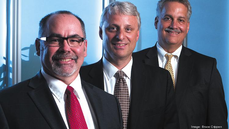 From left are John Lind, managing partner of J. D. Cloud & Co., and John Moster and Carl Coburn of Clark Schaefer Hackett.