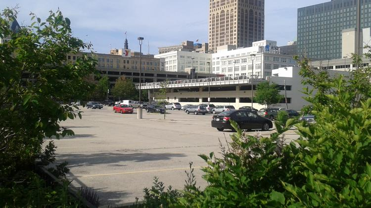 Parking lot at North Second and West Michigan streets: This site was proposed pre-real-estate-bust by a Chicago developer for mixed-use adjacent to the Shops at Grand Avenue. If the site could be incorporated with Extendicare Inc. property to the east, it would connect with Milwaukee's river walk. Site is adjacent to I-794 on/off ramps.