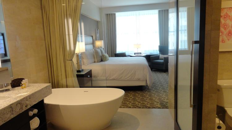 The JW Marriott at 806 Main St. is set to open Aug. 15.  Guest rooms feature spa-like baths and showers with a curtain that can separate the bath area from the bedroom for privacy.  Click through the slideshow for more photos inside the JW Marriott.